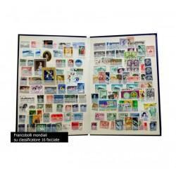 Oltre 1000 Francobolli mondiali usati su classificatore